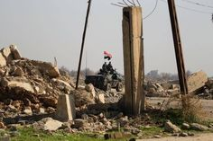 Iraqi forces push into first districts of western Mosul