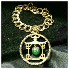 """Wonderfully Unique Vintage Bracelet Asian inspired pretty bracelet. Pretty temple with dangling green bead. Circle chain is 7"""". Vintage Jewelry Bracelets"""