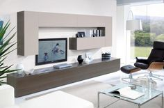This modern wall and floor storage system comprises of 3 metal handled base cabinets. One of the floor cabinets has a drop-down door with a central vertical divide, the other 2 units each have 2 drawers combined behind the smooth ash grey coloured fronts.      On the wall there is 'book-end' pair of 100cm tall storage cabinets with an internal shelf and the same ash grey finish with sandy beige doors, between them are two cabinets with lift up doors.