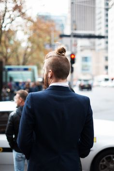 The man bun Undercut hairstyle is a spin-off of the slicked back Undercut. As you can see in the picture of a man bun Undercut, the hair is buzzed very short as per the regular Undercut haircut while Hipster Haircuts For Men, Top Hairstyles For Men, Popular Mens Hairstyles, Hipster Hairstyles, Undercut Hairstyles, Cool Hairstyles, Hairstyle Images, Man Bun Undercut, Mohawk Ponytail