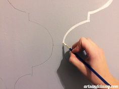 Makeover Edition How to Paint a Moroccan Stencil Accent Wall on a super tight budget of whatever you have in your home. I like keeping my projects on the frugal side,but I always want them to remain classy! Check out this tutorial + download the stencil I used for free! Learn more at www.artsandclassy.com