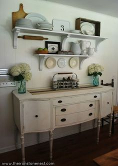 layered shelves over a hutch in the dining room for storage and