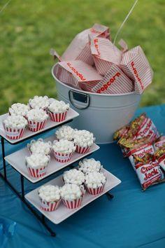 Mini marshmallows on cupcakes to look like popcorn