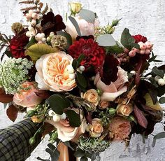 Peach, green, and red bouquet by Swallows & Damsons.