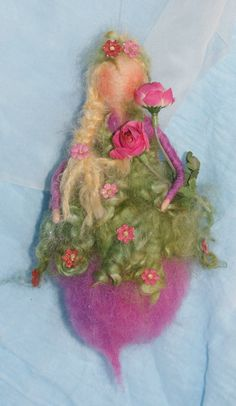 purple Fairy, 8 inch. blond mohair hair and she has a wire in her arms, so she is moveable