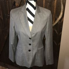 Eli Tahari Heathered grey basic blazer Excellent go to basic blazer I had to have it wore it once.  Hate to see it collect dust.  Has black top stitch detail on pocket flap and top collar. Elie Tahari Jackets & Coats Blazers