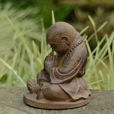 This sculpture of a child monk meditating depicts the path toward Nirvana and is made from volcanic sand and concrete. This reproduction statue will look magnificent in your garden or simply in a special place in your home.