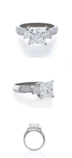 Princess Cut 3.01 G Princess Cut 3.01 G VS2 in Platinum with Princess Cut Side Stones and Round Pave Diamonds. This Beautiful Ring is Set with 34 Pave Diamonds Totaling an Additional 0.76 Carats