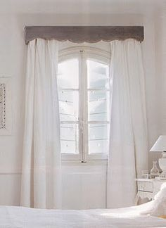 This is a bit girlish, but I love the wood texture with the pure white drapes.