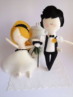 Wedding Dolls - handmade soft bride and groom - Handmade in Italy BY Cromanticamente @Etsy: $80.00. Item MADE TO ORDER for your Wedding! BRIDE: A very glamour bride w/ a white organza dress, embellished w/ black satin ribbons. The bouquet is made w/ felt & cotton flowers. GROOM: Very cool & stylish the wedding dress for him! With black cotton pants, white shirt w/ a black bow tie & braces.. absolutely a fashionable groom! Their eyes & mouth are hand stitched, we used a soft felt to make…