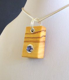 Wood pendant sapphire cubic zirconia in wild olive by axevictimus, £35.00
