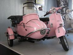pink scooter with side car