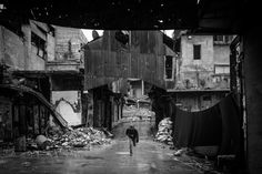 Olivier Voisin, 1974 - 2013 -  A Free Syrian Army soldier runs while being shot at by Assad's snipers in Aleppo, on Jan. 7, 2013.