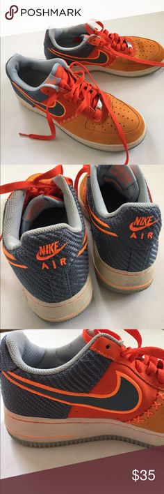 NIKE Air Force 1's Good used condition. Bottom of shoe and sole is in great shape! Slight staining on orange toe (pictured) and normal wear to inside (pictured). Some fuzzies on the grey fabric- but can probably be cleaned up. Nike Shoes Sneakers