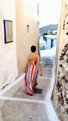 Enjoying a wander on Santorini in my favorite rainbow dress. For more happy, ageless fashion, check out my blog www.thecursingballerina.com!