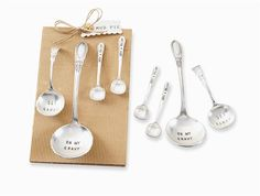 4-piece set.  Assorted vintage inspired servers come on rolled corrugate card. Large size ladles are stamped 'GET SAUCY' and 'OH MY GRAVY' and Small spoons read  'JUST A DOLLOP.'