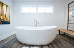 Bathroom Remodel - Bathroom Makeover - Brought to you by Re-Bath of the Triangle. - Asian Themed Bathroom - Tranquil Bathroom Design - Oversized Freestanding Tub - Skylights in the bathroom
