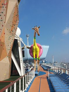 Anthem of the Seas. The ship's resident 32-foot-tall giraffe, Gigi, is always in-fashion and pool-ready with her pink inner tube.