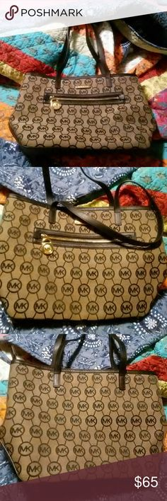 Pre Loved Michael kors handbag Almost like New . zipper on front and inside with two pocket on the inside . made of a woven material .15inc.wide 10inc long handle 23inc. This handbag came from Macy's. Michael Kors Bags Satchels