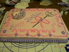 Pretty simple princess first birthday sheet cake with tiara and sceptor.