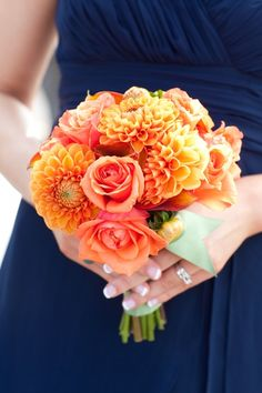 Orange dahlia and rose bouquet... i love these colors for a fall wedding