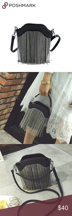 HPTHE MELISSA SMALL BUCKET CHAIN BAG THE MELISSA SMALL BUCKET CHAIN BAG STRUCTURED PU LEATHER SOLID BACK AND SILVERTONE CHAIN DETAIL IN FRONT COME WITH SMALL CARRY HANDLE AND A SHOULDER STRAP WITH A DROP OF A LITTLE OVER 21 INCHES BAG IS ROUGHLY A LITTLE OVER 6 INCHES LONG BY ROUGHLY 7 INCHES HIGH ZIPPER TOP ADD A LITTLE EDGE TO ANY OUTFIT PRICE FIRM UNLESS BUNDLED SORRY NO TRADES Bags Mini Bags