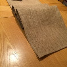Check out this item in my Etsy shop https://www.etsy.com/uk/listing/269926064/hessian-table-runner-fully-hemmed-35cm