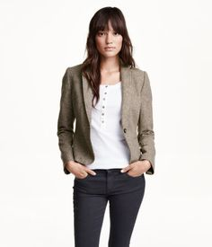 Fitted, single-breasted blazer in a wool blend with a classic collar and lapels. Welt pockets at front, buttons at cuffs, two-tone elbow patches, and one inner pocket with button. Vent at back. Lined.