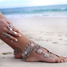 """Adorn your feet with this antique silver coin foot jewelry. Coins are 0.6"""" in diameter. Length of anklet is 10"""" with an adjustable length of 2.7"""". Perfect jewelry wear for your next beach vacation or"""