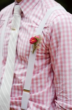 Dapper groom in pink plaid and suspenders for wedding day #pink #groom #suspenders  Photo by: Rachel Peters Photography on Every Last Detail