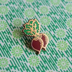 Enamel Pin of fresh red beets with green stem and leaves