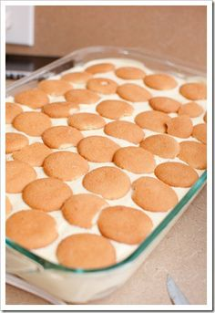 Paula Deen's Banana Pudding    4 bananas, sliced    3 cups milk    1 box Nilla Wafers    2 small boxes instant FRENCH vanilla pudding    1 {8 oz.} pkg. cream cheese    1 {14oz.} can sweetened condensed milk    1 {12 oz.} container Cool Whip    Line the bottom of a 9x13 with Nilla Wafers.  {The original recipe called for Pepperidge Farm Chessmen coo