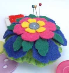 Pin cushion felt pin cushion flower pin cushion by ChickFromLeeds Shades Of Green, Blue Green, Yellow, True Colors, Colours, Felt Pincushions, Blanket Stitch, Sewing Tools, Sewing Accessories