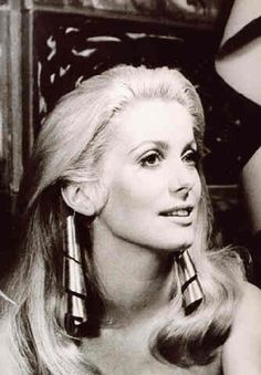 Deneuve wearing Man Ray.