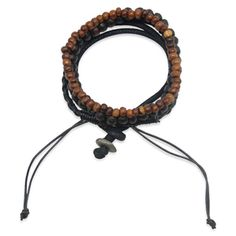 $32.00 Justin Bracelet  The Justin Bracelet embodies masculine exoticism for casual confident looks. Comprised of wooden beads in both brown and black and black leather cord, this bracelet is perfect for the business man with an edge.