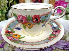 AYNSLEY TEA CUP AND SAUCER CREAM & FLORAL PATTERN TEACUP & SAUCER
