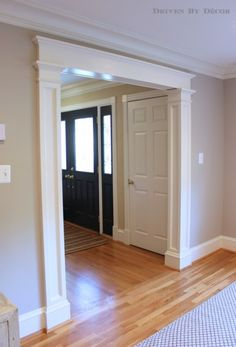 Molding added to a standard doorway makes such a huge difference!