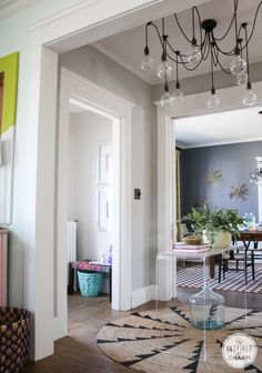 Shut the Front Door. Love this acrylic table, entry bench, light, and over all feel here.