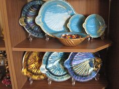 fish designed dish and plate sets are all different techniques and my favorite is the Turquoise and gold set