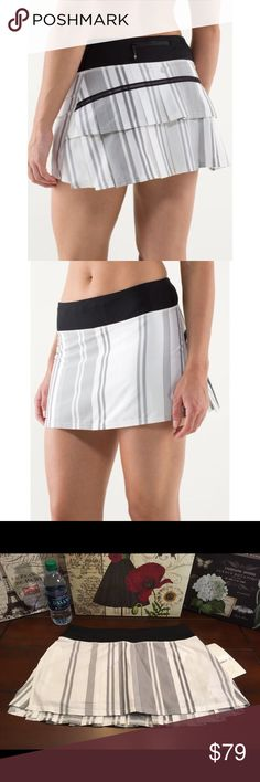 Lululemon Pace Setter Skirt-Groovy Stripe, Size 8 Lululemon Pace Setter Skirt-Groovy Stripe Nimbus, Size 8  Brand new with tag! ☺Lulu Pace Setter skirt in black, gray, and white Groovy Stripe Nimbus print. This skirt is both cute and practical with a striped pattern, shorts underneath and multiple pockets (two hidden interior, one zipper pocket in back). There is also a mesh pocket on the shorts underneath for tennis balls. Release date July 2013.   Length-12 inches in front; 13 inches in…