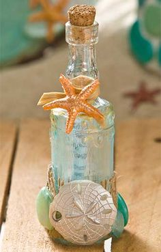 Message in a Bottle Wedding Favor - Beach themed wedding #DIY ideas designed by Cathie  Steve - click thru for the  full tutorial using Mod Podge #modpodge #plaidcrafts #beachwedding