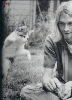Kurt Cobain Playing With Cat