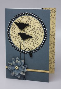 handmade card ... luv the poppy die cut in black as silhouette ... like the use of print papers for the large circle and the framing layer ... lovely card ...