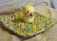 Hand made/New Lovie Blanket with Duckie. A great gift for a little one. Acrylic/Polyester. Chenille yarn style. $20. + S/H $5.00 If you prefer to have it mailed. Washable: delicate wash or hand wash Dry: low heat or lay flat to dry.