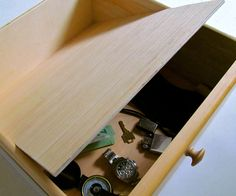 This step by step tutorial of how to build a false bottom secret compartment drawer is a simple do it yourself project that can hide valuables from plain sight contained within a drawer. Hidden Spaces, Hidden Rooms, Secret Space, Secret Rooms, Secret Storage, Hidden Storage, Closet Storage, Secret Compartment Furniture, Stash Spots