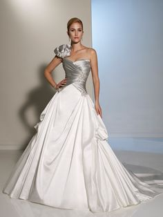 Style Y11200, Primalia, is a beautiful satin wedding gown with back corset designed by Sophia Tolli, click here for more details on this style.