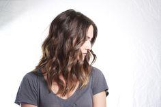 Wavy brown medium length hairstyle