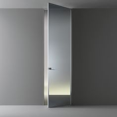 Flush swing door Moon is available in the new reflecting and acyd glass finishings.