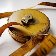 vintage retractable tape measure in metal case by AtticAntics