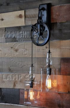 This is a wall sconce version of our popular Warehouser Pendant Lamp. The wheel is 7.75 across and the 9 tall bottles hang down 29 from the hook.